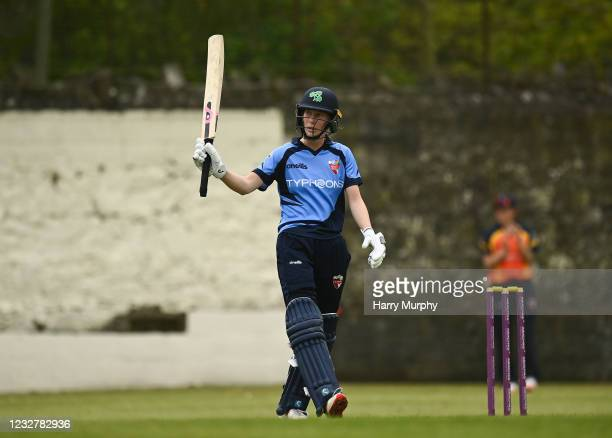Dublin , Ireland - 9 May 2021; Orla Prendergast of Typhoons raises her bat as she reaches 100 during the third match of the Arachas Super 50 Cup...