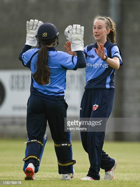 Dublin , Ireland - 9 May 2021; Orla Prendergast of Typhoons, right, celebrates running out Jenny Sparrow of Scorchers with wicketkeeper Amy Hunter...
