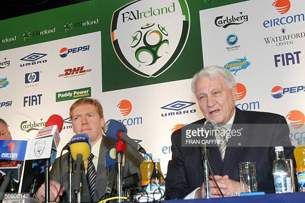 Football Association of Ireland new International Soccer Team Manager Steve Staunton talks with his assistant Sir Bobby Charlton speaking at a press...