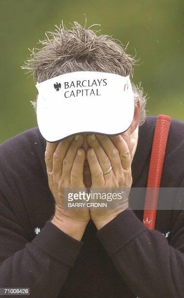 Ireland's Darren Clarke gestures on the 18th hole of the Nissan Irish Open Golf tournament in Kildare in Ireland, 22 May 2006. Denmark's Thomas Bjorn...