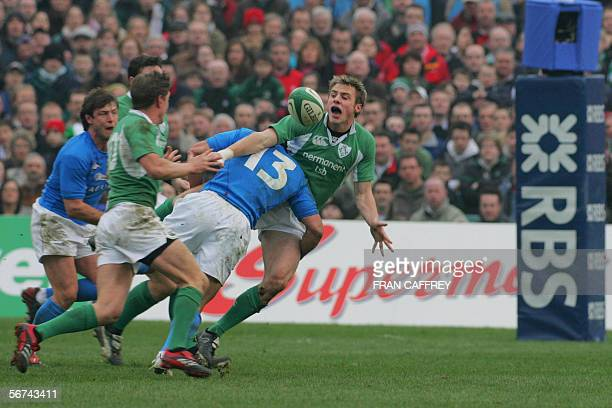 Ireland's No 11 Tommy Bowe passing the Ball to Ireland's No 10 Ronan O'Gara as Italian no 13 Ganzalo Vanale takes him down during the opening match...