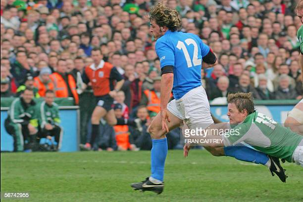 Italy's no 12 Micro Bergamasco makes for the try as Ireland's no 13 Brian O'Driscoll tries to take him down during the opening match of the Six...