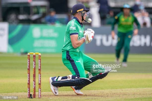 Dublin, Ireland July 11. Harry Tector of Ireland is hit on the grill protector of his helmet from a delivery from Anrich Nortje of South Africa...