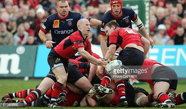 Munster's Irish scrum half Peter Stringer clears the ball during the MunsterPerpignan Heineken rugby union cup quarter final at Lansdowne Road...