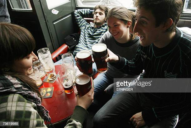People drink pints of beer in Hogan's Pub during the annual St Patrick's Day in Dublin 17 March 2007 Hundreds of thousands of revellers throughout...