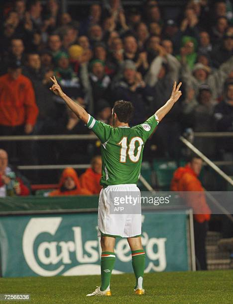 Robbie Keane of Ireland celebrates with the crowd after scoring aganist San Marino 15 November 2006 during the first half of the European 2008 Group...