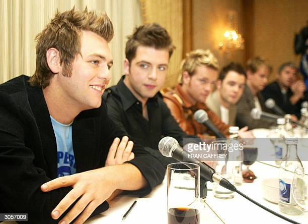 Westlife band member Brian McFadden sits with fellow band members Mark Feehily Nicky Byrne Shane Filan and Kian Egan at press conference to announce...