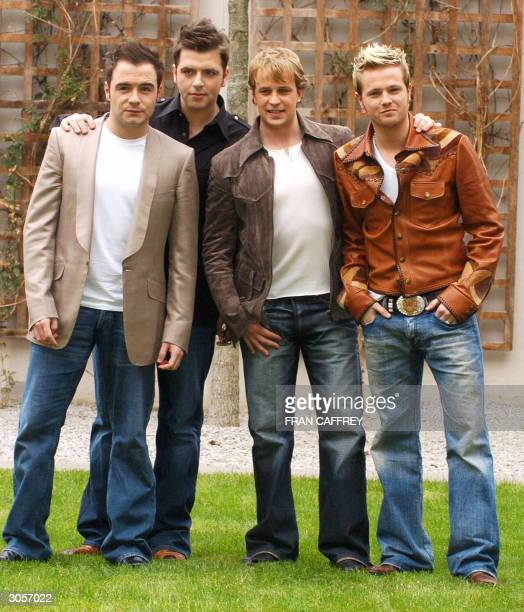 Westlife band members Shane Filan, Mark Feehily, Kian Egan and Nicky Byrne, pose for pictures as the new Westlife after a press conference to...