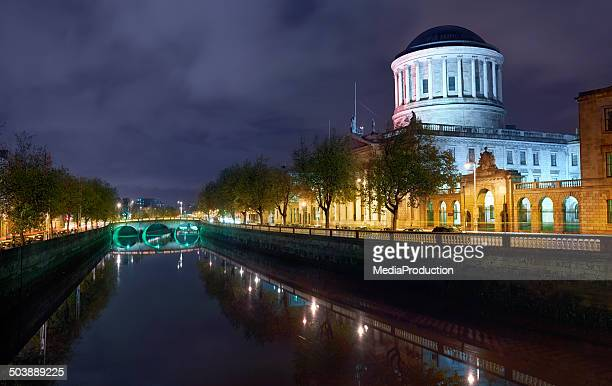 Dublin river liffey and court house illuminater at night
