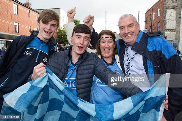 Dublin supporters the McMahon family Michael Niall Cathy and Ronan pose for a photograph outside Croke Park ahead of the GAA AllIreland Gaelic...