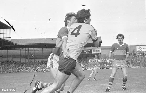 Dublin's David Foran being tackled by Kerry's Pat Spillane as Kerry's Denis 'Ogie' Moran and Mickey Sheehy await the outcome during the Dublin v...