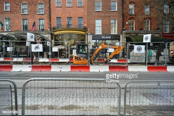 Dublin's Dawson Street looks like a construction site with the ongoing works of the Luas Cross City project with the existing Luas Green Line beeing...