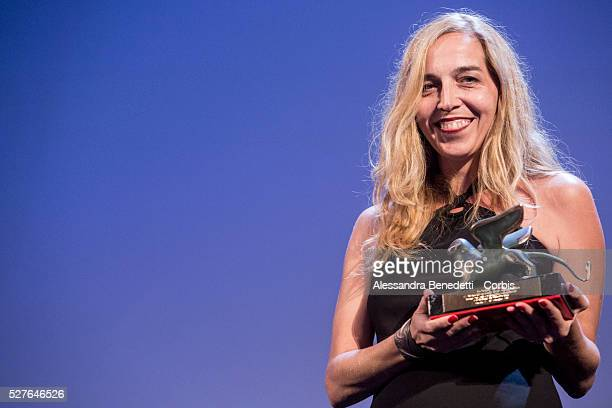 Dubravka Turic holds the Orizzonti award for best short movie BellaDonna during the 72nd International Venice film Festival awards ceremony