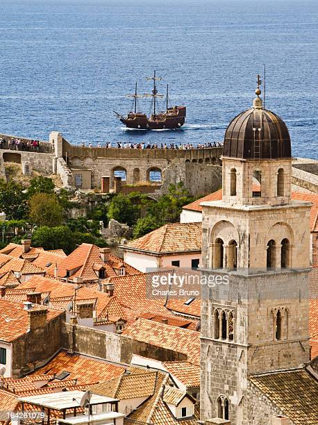 CONTENT] Dubrovnik roof tops sailing ship in the background