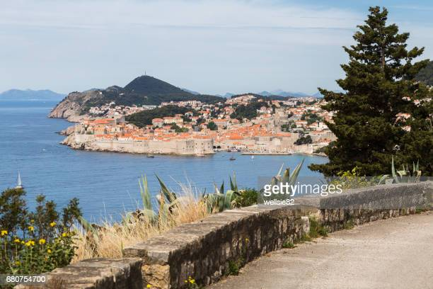 Dubrovnik's old town seen over a curving coastal road