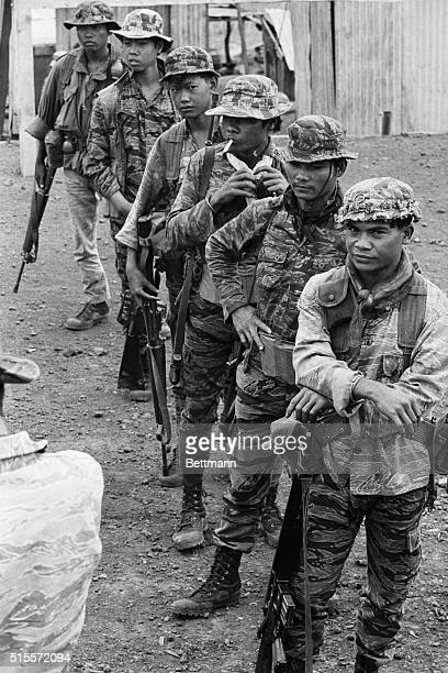 Montangard tribesman dressed in battle gear line up at the Duc Lap Special Forces camp near the Cambodian border recently The Montagnards are...
