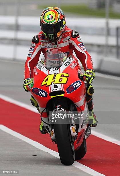 Ducati rider Valentino Rossi of Italy returns to his garage after the first practice session of the Malaysian Grand Prix MotoGP motorcycling race at...