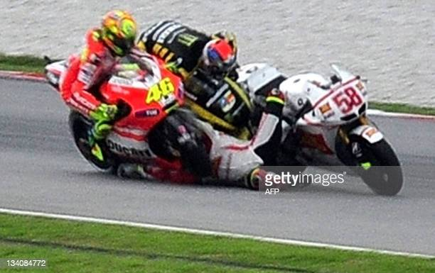 Ducati rider Valentino Rossi of Italy Yamaha rider Colin Edwards of the US and Honda rider Marco Simoncelli of Italy collide at turn 11 of the Sepang...
