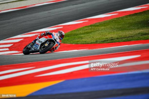 Ducati team italian rider Andrea Dovizioso rides his bike during a qualifying session for the San Marino Moto GP Grand Prix race at the Marco...