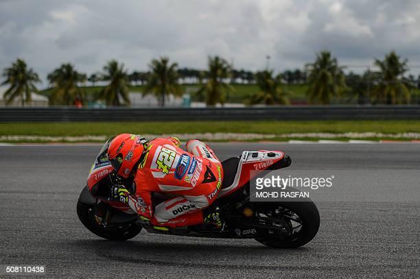 TOPSHOT Ducati Team Italian rider Andrea Iannone takes a corner during the last day of 2016 MotoGP preseason test at the Sepang International circuit...