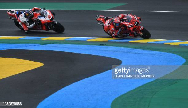 Ducati Team Italian's rider Francesco Bagnaia competes ahead of Pramac Racing French rider Johann Zarco during the 1st free practice session of the...