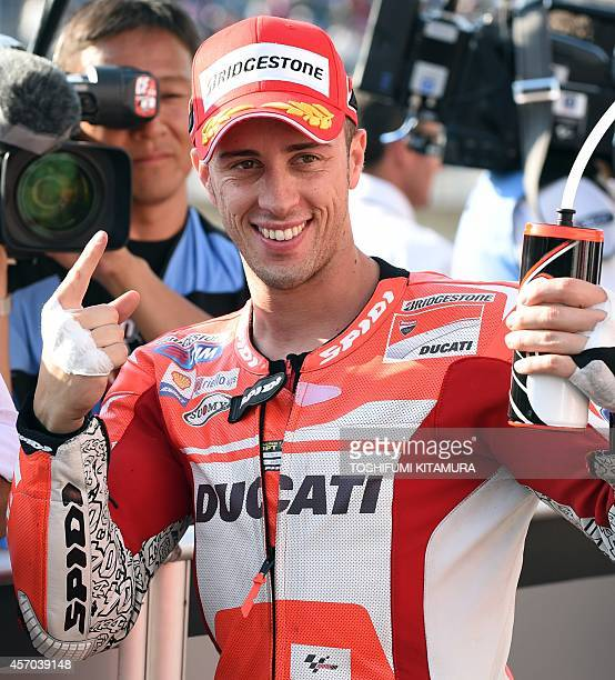 Ducati Team rider Andrea Dovizioso of Italy gestures at the parc ferme after getting the pole position in the MotoGPclass qualifying session of the...