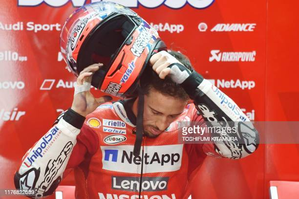 Ducati Team rider Andrea Dovizioso of Italy prepares for the MotoGP third free practice session of the Japanese Motorcyle Grand Prix at the Twin Ring...