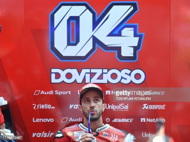 Ducati Team rider Andrea Dovizioso of Italy watches a TV monitor during the MotoGP fourth free practice session of the Japanese motorcycle Grand Prix...