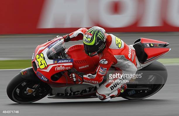 Ducati Team rider Britain's Cal Crutchlow takes a corner during the qualifying session for the MotoGP race at the motorcycling British Grand Prix at...