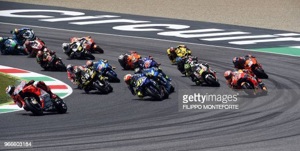 Ducati Team' Spanish rider Jorge Lorenzo leads the pack at the start of the Moto GP Grand Prix at the Mugello race track on June 3 2018