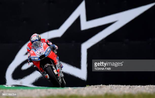 TOPSHOT Ducati Team's Italian Andrea Dovizioso steers his bike during a free practice session ahead of the Italian MotoGP Grand Prix at the Mugello...