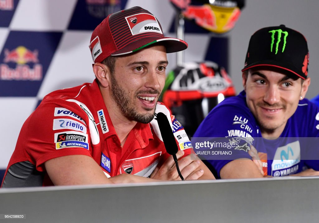 Ducati Team's Italian rider Andrea Dovizioso (L) and Movistar Yamaha MotoGP's Spanish rider Maverick Vinales attend a press conference during the Red Bull Grand Prix of Spain at Jerez de la Frontera race track on May 3, 2018.