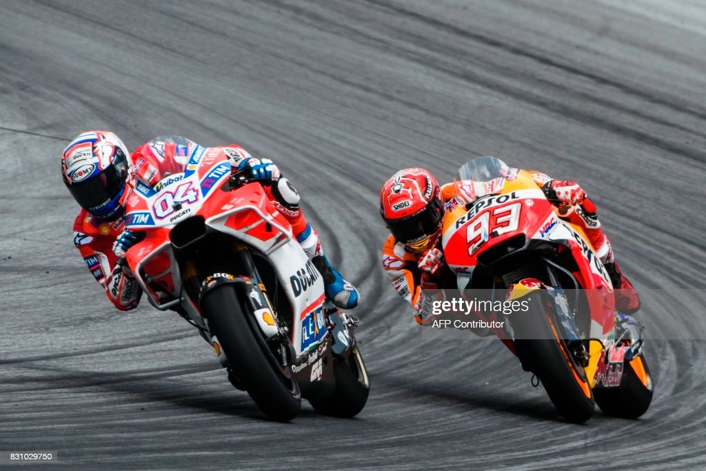 Ducati Team's Italian rider Andrea Dovizioso (L) and Repsol Honda Team's Spanish rider Marc Marquez compete during the MotoGP Austrian Grand Prix race at Red Bull Ring in Spielberg, Austria on August 13, 2017. / AFP PHOTO / Jure Makovec