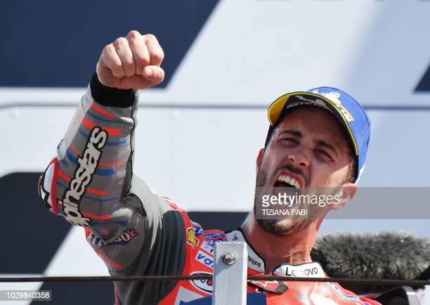 TOPSHOT Ducati Team's Italian rider Andrea Dovizioso celebrates victory on podium of the MotoGP race of the San Marino Grand Prix at the Marco...