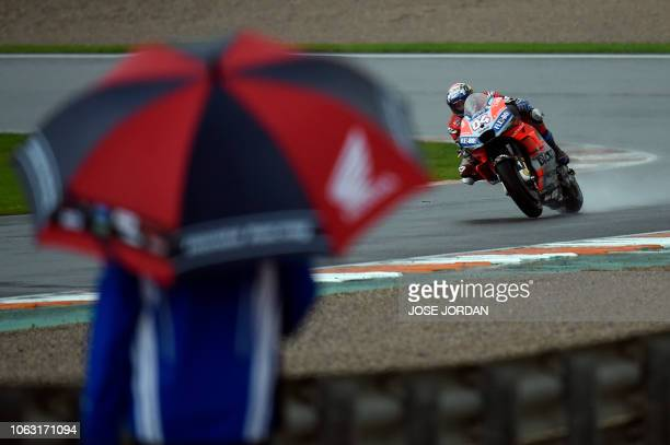 Ducati Team's Italian rider Andrea Dovizioso competes during the MotoGP race of the Valencia Grand Prix at the Ricardo Tormo racetrack in Cheste, on...