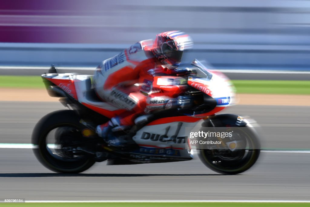 TOPSHOT - Ducati Team's Italian rider Andrea Dovizioso exits Village Corner during the MotoGP Warm Up session of the British Grand Prix at Silverstone circuit in Northamptonshire, southern England, on August 27, 2017. / AFP PHOTO / Oli SCARFF