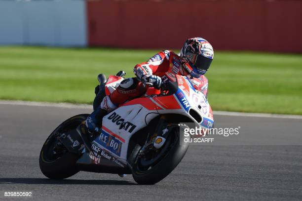 Ducati Team's Italian rider Andrea Dovizioso leads during the MotoGP race of the British Grand Prix at Silverstone circuit in Northamptonshire...