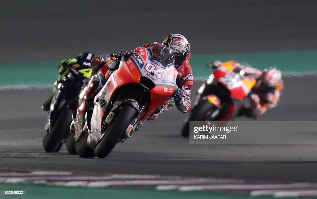 TOPSHOT - Ducati Team's Italian rider Andrea Dovizioso leads the pack during the 2018 Qatar Moto GP Grand Prix at the Losail International Circuit in Lusail, north of Doha, on March 18, 2018. /