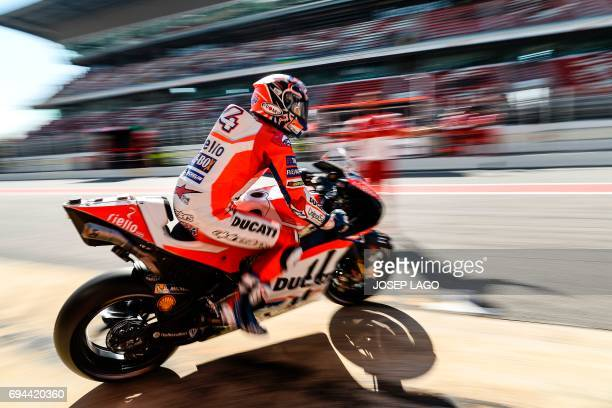 Ducati Team's Italian rider Andrea Dovizioso leaves the pit during the third MotoGP free practice session of the Moto Grand Prix de Catalunya at the...