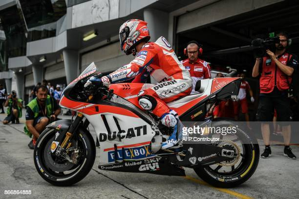 Ducati Team's Italian rider Andrea Dovizioso leaves the pit lane during the first practice session of the Malaysia MotoGP at the Sepang International...