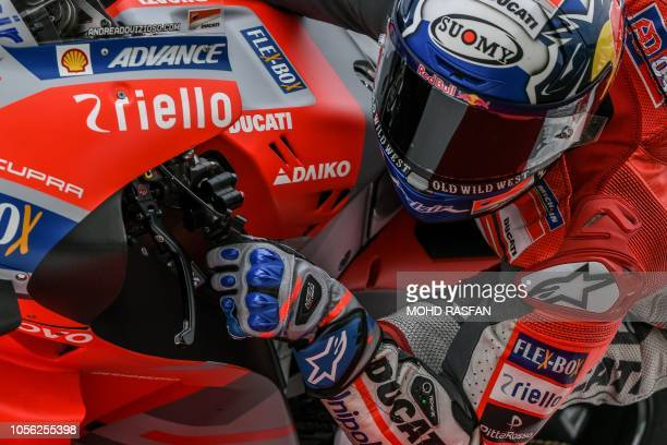 Ducati Team's Italian rider Andrea Dovizioso negotiates a corner during the second practice session of the Malaysia MotoGP at the Sepang...