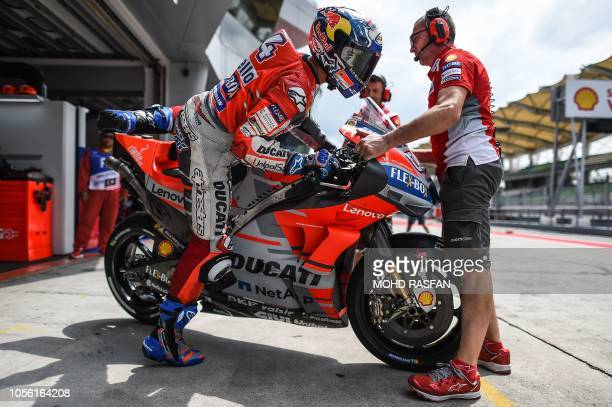 Ducati Team's Italian rider Andrea Dovizioso prepares to leave the pit lane during the first practice session of the Malaysia MotoGP at the Sepang...