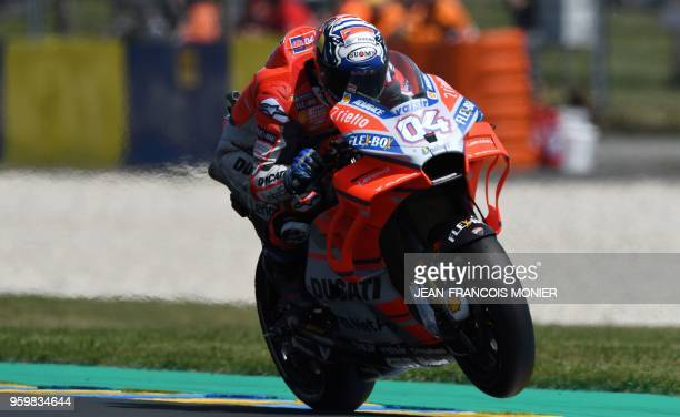 Ducati Team's Italian rider Andrea Dovizioso rides during a MotoGP free practice session ahead of the French Motorcycle Grand Prix on May 18 2018 in...