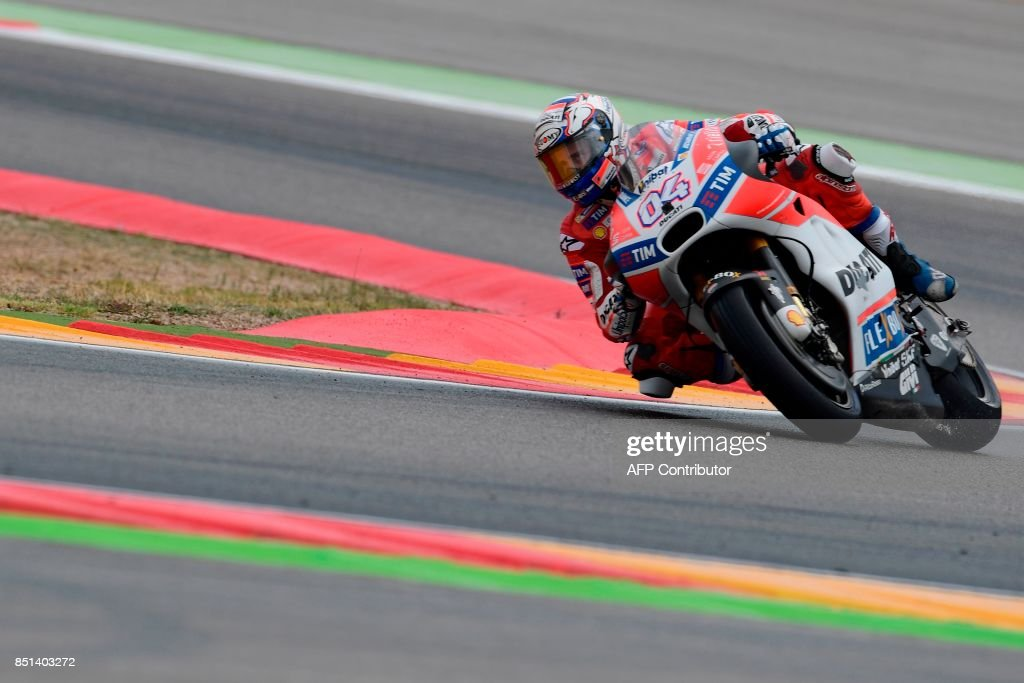 Ducati Team's Italian rider Andrea Dovizioso rides during the Moto GP second free pratice of the Moto Grand Prix of Aragon at the Motorland circuit in Alcaniz on September 22, 2017. /
