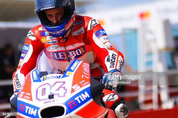 Ducati Team's Italian rider Andrea Dovizioso rides his bike out of the pit during a free practice session for the San Marino Moto GP Grand Prix race...