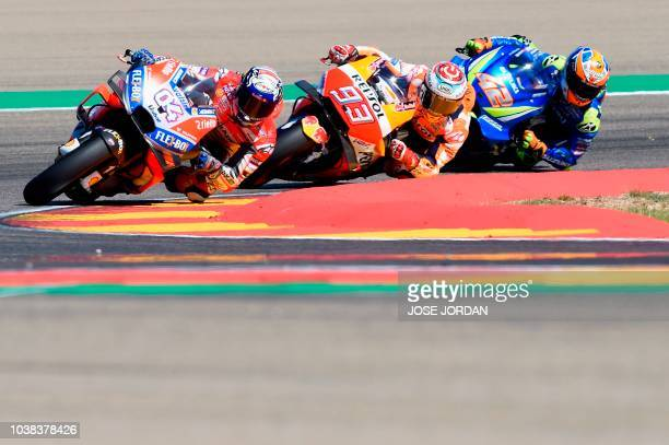 Ducati Team's Italian rider Andrea Dovizioso rides in front of Repsol Honda Team's Spanish rider Marc Marquez and Team SUZUKI ECSTAR's Spanish rider...