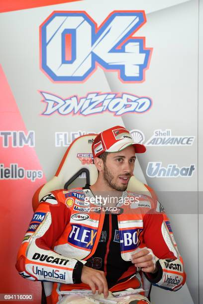 Ducati Team's Italian rider Andrea Dovizioso sits in pits during the second MotoGP free practice session of the Moto Grand Prix de Catalunya at the...