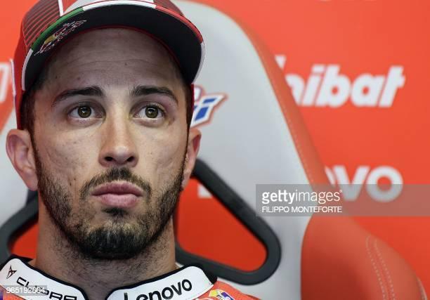 Ducati Team's Italian rider Andrea Dovizioso sits in the box during a free practice session ahead of the Italian MotoGP Grand Prix at the Mugello...