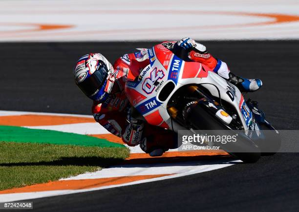 Ducati Team's Italian rider Andrea Dovizioso takes a curve during the first MotoGP free practice session of the race of the Valencia Grand Prix at...