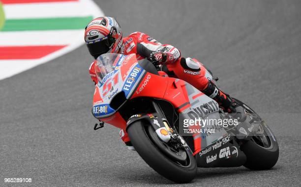 Ducati Team's Italian rider Michele Pirro steers his bike during a free practice session ahead of the Italian MotoGP Grand Prix at the Mugello...